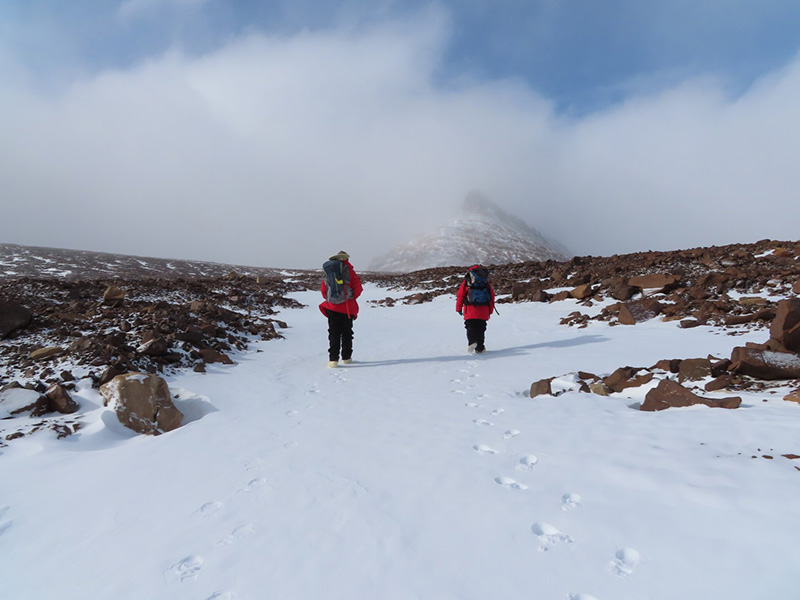 Kate Swanger (left) and Missy Eppes walk along the Beacon Valley in search of rock samples to collect.
