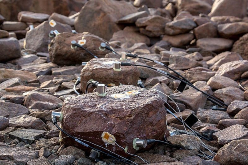 The team is hoping that the four rocks wired up with acoustic emission sensors will collect data throughout the austral winter.
