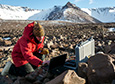 At the far end of the McMurdo Dry Valleys, Jen Lamp performs some final checks before leaving her experiment out for the austral winter.