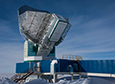 The South Pole Telescope's 10 meter dish points at the sky during the austral summer