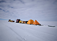 The traverse's two tracked vehicles pull sleds full of their supplies and tents towards the 88-South line of latitude