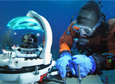 Paul Cziko dives under the frozen ice to install the McMurdo Oceanographic Observatory