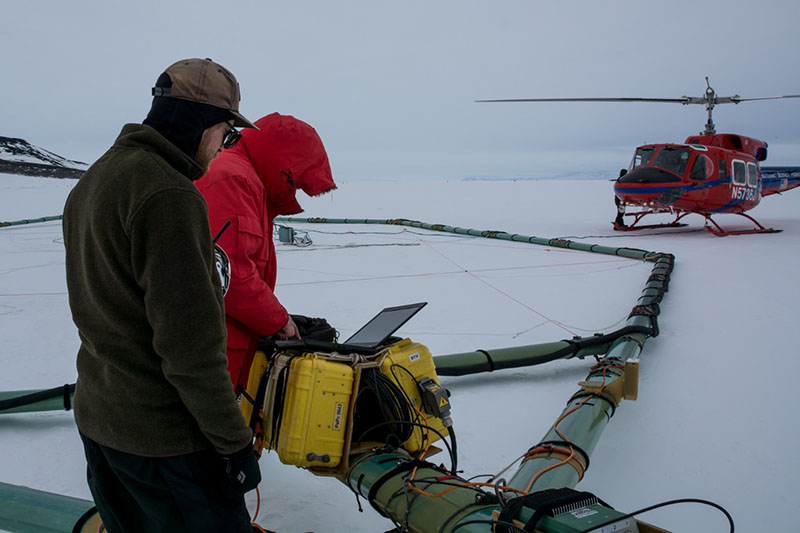 Denys Grombacher (foreground) and Lars Jensen make final adjustments to SkyTEM before it takeoff