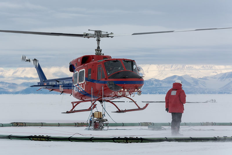 As the helicopter lifts off carrying SkyTEM, Lars Jensen makes sure the instrument gets off the ground safely