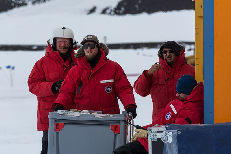 (Left to right) Lars Jensen, Denys Grombacher, Slawek Tulaczyk and Nikolaj Foged monitor the liftoff of SkyTEM from their fish hut near McMurdo Station